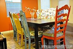 Love the combination fo the different colored chairs and the bright colored fabric