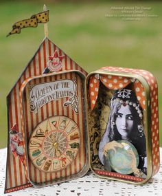Wicked circus altered tin.  Made by rackycoo.  This is a good one to study to see how to layer elements.