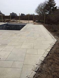 Bluestone pool patio with Belgium block edging Nantucket