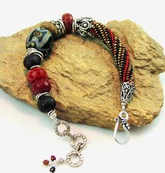Asymmetrical Chunky Stone, Lampwork and Sterling Silver Bracelet in Rust, Black and Tan. $125.00, via Etsy.