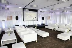 White leather lounge furniture creates a modern club feel. Leather couches and ottomans available for rent. White wall draping finishes the modern look by creating clean lines and structure. Leather Lounge, Leather Couches, Chair Cover Rentals, Chiavari Chairs, Modern Lounge, Fine Linens, Lounge Furniture, Chair Covers, White Walls