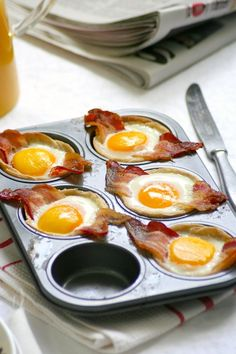 eggs bacon and bread. put bread cut in a round shape into a cupcake mold. add partially cooked bacon, add an egg.bake 7 mins or if u want softer watch . Vegan Recipes Videos, Egg Recipes, Brunch Recipes, Breakfast Recipes, Cooking Recipes, Healthy Recipes, Snacks Für Die Party, Breakfast For Dinner, Easy Cooking