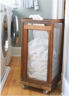 laundry bin from old window screens + wheels///I could use the 12 old window panes from the basement and make 3 of these. then they can be kept in the bathroom laundry room and just rolled out when full. Genious recycle Tara!