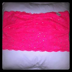 New Victoria's Secret PINK Lace Sparkle Bandeau This Gorgeous Bandeau by Victoria's Secret PINK is Hot Pink Lace, has Rhinestones to give it a Beautiful Sparkle, Lined in the front, has a support rod on either side, & an Adorable Silver Heart P on the top center of the back! Perfect to wear under that see through, lace, or crochet top & the perfect Hot Pink color for the Summer season!!! PINK Victoria's Secret Intimates & Sleepwear Bandeaus