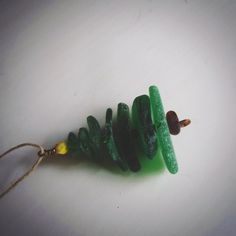 This is Beach Glass that I collected from Lake Champlain in Vermont. I cleaned it, drilled it and put it together on a wire with brown beach glass as a stem and a yellow bead as the star on top. Sea Glass Beach, Sea Glass Art, Sea Glass Jewelry, Glass Earrings, Silver Earrings, Sea Glass Crafts, Shell Crafts, Green Lake, Green Beach