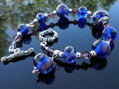 SOLD !! #Lampwork Bead Bracelet Handmade Glass by BrooklynBeadGoddess, Purple and blue glass beads with sterling silver and swarovski crystals