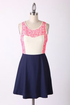 PINK and white dress with navy skater skirt. www.sisterkatesboutique.com