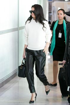 Selena Gomez looks super stylish as she catches a flight at Charles de Gaulle Airport in Paris, France. September 29, 2015.