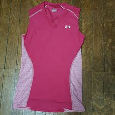 NWOT Under Armour tank NWOT Under Armour heat gear tank top. Magenta color with a light pink patterned side. Size XL. This is a fitted tank top. No trades. Under Armour Tops Tank Tops