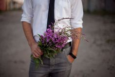 Who says flowers are just for the #bride?  These #grooms look fabulous with a dash of floral color.