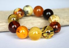 From Lithuania a massive Baltic amber bracelet, multicolour by AmberDesign8