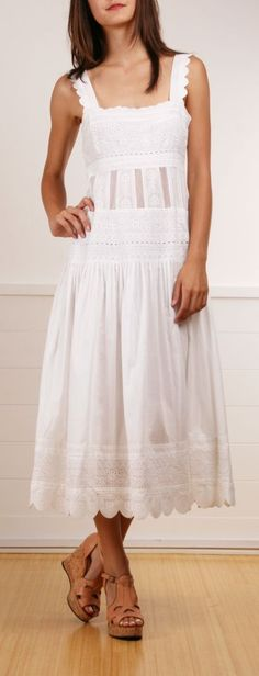 This is the kind of peasant girl wedding dress I always imagined for myself.  It would have to be floor length though but I like the style of it