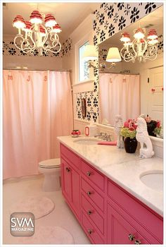 Pink Powder Room. Everything pink. Love the chandelier in the bathroom. @Tiffany Byrd