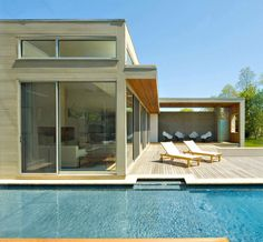 Architecture, Astonishing And Clear Rectangular Swimming Pool Of Open Plan House Design Beautified With Apply Two Wooden Wheel Lounge Seats On The Deck Facing To The Pool: Open Plan House as Contemporary Fieldview Residence in NY with Pool
