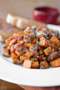 Autumn Sweet Potato Hash with spicy sausage, sweet bell peppers and caramelized onions. For Phase 1, use nitrate-free chicken or turkey sausage and skip the sprinkle of cheese.