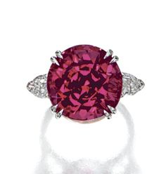 SPINEL AND DIAMOND RING, BULGARI The round spinel weighing 16.43 carats, flanked by 2 modified pear-shaped diamonds, mounted in platinum, size 5¾, signed Bulgari.