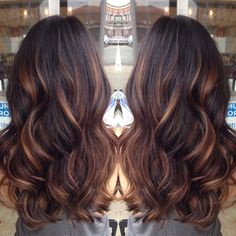 golden caramel balayage'd lights on her dark brown hair