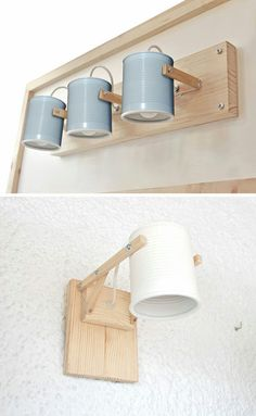 Design studio iLiui, have created this modern wall lamp that uses wood and matte painted recycled tin cans as part of the design. lamp These simple lamps use recycled tin cans as lamp shades Diy Wand, Diy Luz, Mur Diy, Recycled Tin Cans, Recycled Lamp, Recycled Home Decor, Deco Luminaire, Ideias Diy, Wooden Lamp