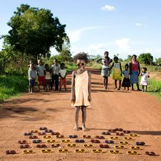 Gabriele Galimberti: Toy Stories - 'Maudy Sibanda, aged 3, from Kalulushi, Zambia. Maudy was born in a hut in a small village close to Kalulushi. She grew up playing on the street with all the other children from the village. In the village, there are no shops, restaurants or hotels, and just a few children are lucky enough to have some toys. Maudy and her friends found a box full of sunglasses on the street some weeks ago – and from that moment on, those sunglasses are their favourite…