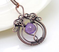 Wire wrapped copper necklace, Purple amethyst necklace, Amethyst birthstone wire wrap jewelry, handmade, gothic necklace, Copper jewelry. $85.00, via Etsy.