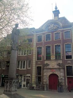 The old Butterhall at the Marketplace with the Judith Monument for the fallen in WW2. Breda, The Netherlands.