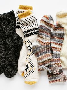 Staycation Pom Pom Sock | Multi-colored stripes adorn these ultra comfy ribbed ankle socks with an adorable pom pom accent at the opening.