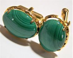Vintage green malachite cuff links Oval cabochon set in a gold tone alloy metal, prong set stones Unsigned 1/2 x 3/4 inches Good vintage condition, shows no wear Internatio... #gotvintage #vogueteam #1960s