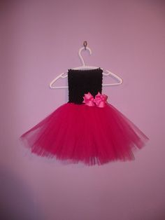 Oh my, this tutu dress is gorgeous! I love the pink the black together, and the bow just sets it off. Stunning! :)