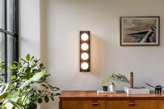 The Pearl 4 wall light with bronze finish machined brass frame, opal glass globes and tinted acrylic panels Tea Lights, Wall Lights, Acrylic Panels, Glass Globe, Bronze Finish, Globes, Opal, My Design, Brass
