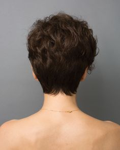Dramatic tapered and asymmetric style with curly layers that gradually fall to the side of the face. Featuring Open Wefted Cap and Adjustable Straps. Short Curly Pixie, Short Dark Hair, Short Pixie Haircuts, Short Hair Cuts, Bob Hairstyles For Thick, Pixie Hairstyles, Pixie Cut Kurz, Textured Hair, Hair Looks