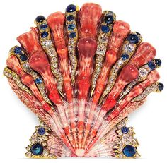 Verdura natural shell brooch with cabochon sapphires and diamonds.  Verdura used natural shell in a wide variety of jewelry and handbags.