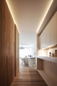 Like the uplights and contrast w/ wood and lacquer cabinets  Loft MM by C.T. Architects designed as an accessible home for a wheelchair user