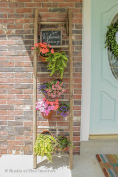 How to make a vertical garden and welcome sign from a ladder, terra cotta pots, and floral wire.
