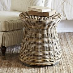 Rivera Rattan Side Table   Handcrafted from rattan in a weathered driftwood finish, this side table's simple silhouette makes it an all-purpose option that can be used in most rooms.