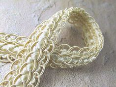 Ivory scalloped 20mm or 3/4 inch fancy braided decorator gimp trim with a…