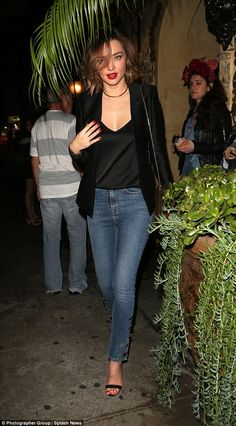 Angels, assemble! Miranda Kerr may have hung up her wings in 2013, the supermodel proved she and the rest of the Victoria's Secret angels are still as close as ever as they enjoyed a girls' night on Wednesday evening