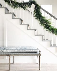 White staircase with shiplap and board and batten with gray stairs.