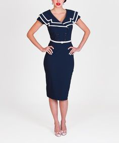 Enjoy the curve-skimming comfort of this stretch-blend midi and delight in the vintage appeal of a sailor collar and double-breasted design.
