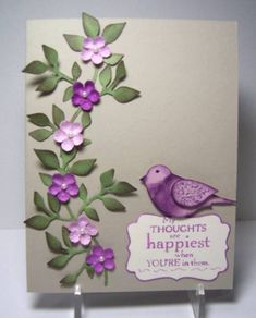 handmade card .. gray base ... column of die cut leaves with punched purple and lavender flowers with sweet little pearls .... two step bird sittin on top of sentiment  tag ... Stampin' Up!