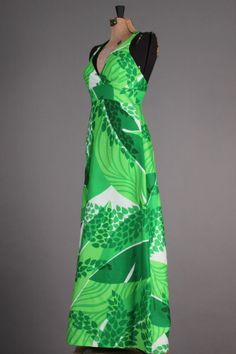 60s-70s VTG Malia Honolulu Tropical Green Hawaiian Maxi Halter Lounge Dress. A vibrant, full-length vintage dress in amazing condition! The Malia label, owned by William & Mary Foster, was known for exploring bold graphics in bright prints and this dress is a perfect example of their work. Size M - $129 via eBay