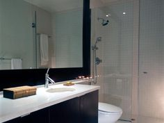 The right tile improves the style of your bathroom. Learn the pros and cons of different tiles, then pick the perfect one for your space. Floating Bathroom Vanities, Bathroom Vanity Makeover, White Vanity Bathroom, Bathroom Photos, Bathroom Styling, Bathroom Ideas, Bathroom Mirrors, Bathroom Tile Designs, Bathroom Renos