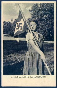 This postcard features a young women from the League of German Girls, which was the wing of the Nazi Party girls' youth movement, sometimes simply referred to as the Hitler Youth. This female branch of the Hitler Youth Movement was officially founded in Nazi Propaganda, German Women, German Girls, Raza Aria, Prinz Eugen, Ww2 Pictures, Picture Postcards, American Soldiers, Military History