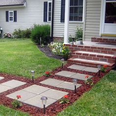 Lava Rock & concrete pavers ...interesting pathway, looks great with red brick!