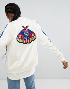 Buy it now. adidas Originals Embellished Arts Bomber Jacket With Butterfly Embroidery - Cream. Bomber jacket by Adidas, Midweight silky-feel fabric, Baseball collar, Zip fastening, Raglan sleeves, adidas Originals logo to chest, Embroidered back, Functional pockets, Fitted trims, Regular fit - true to size, Machine wash, 100% Polyester, Our model wears a UK 8/EU 36/US 4 and is 168cm/5'6 tall. With a brand history stretching back more than 60 years, adidas draws inspiration from street…
