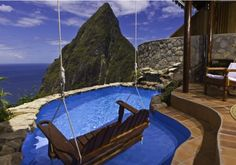 Ladera Hotel, Saint Lucia. It sits on a forested ridge at 1,100 feet overlooking the volcanic Piton Mountains and the Caribbean Sea.