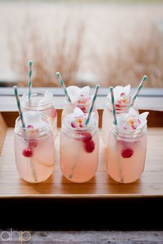 pucker up punch - signature drink? Grapefruit flavored-vodka, and pink lemonade :) Love the mason jars