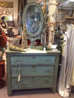 A beautiful dresser and mirror painted in Provence Chalk Paint® decorative paint by Annie Sloan | By Teresa Howell of Faith Hope Love Vintage - A shop in A Classy Flea - Marietta, GA