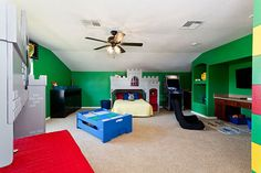 This Lego themed bedroom features two castle bunk beds and plenty of space for building Lego creations during your Orlando vacation