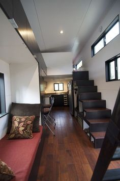 Tiny House On Wheels Featuring a Smart and Modern Design- this one is my favorite by far. I am not over the moon about a sleeping loft but the storage stair case helps.