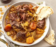 Curried Lamb with Apricots & Almonds -- since the curry is sweet, serve it over cooked long-grain brown rice for a nutty, earthy flavor, or with couscous or steamed, stemmed spinach.